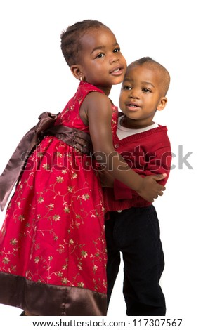 Little African American Sister and Bother Hug Each Other on White Background - stock photo