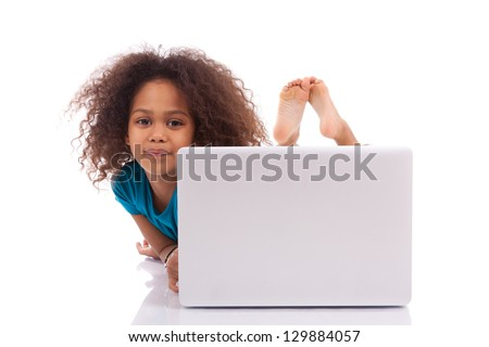 Little african asian girl using a laptop, isolated on white background - stock photo