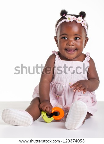Little African girl are being photographed in the studio. - stock photo