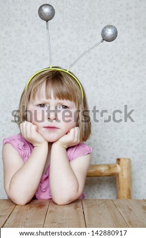 Little Alien - Girl wearing Antennas - stock photo