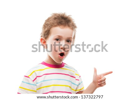 Little amazed or surprised child boy hand gesturing or index finger pointing - stock photo