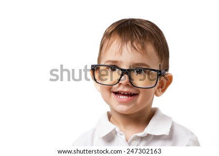 little amusing smiling boy in big glasses looking up on white background - stock photo