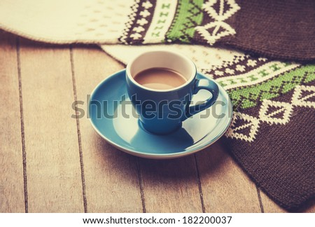 Little and empty white cup for a coffee or tea on a wooden table - stock photo