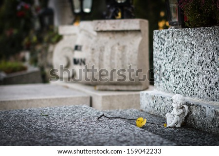 Little angel on the grave. Selective focus. - stock photo