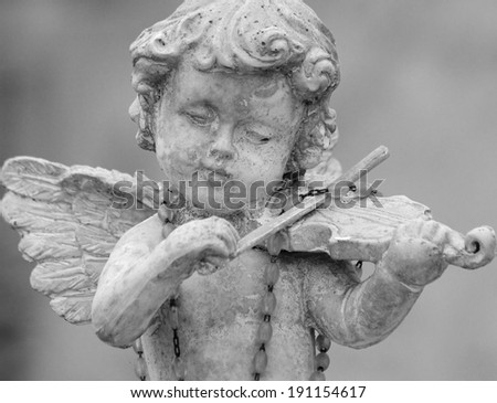 little angel playing violin -  detail of cemetery decor, Italy  - stock photo