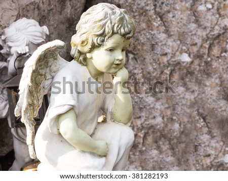 Little angels in the tomb - stock photo