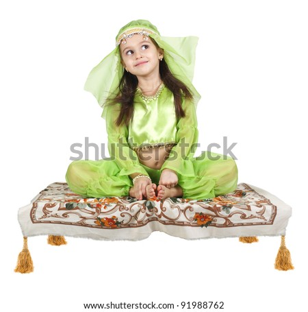 little arabian girl sitting on a flying carpet isolated on white background - stock photo