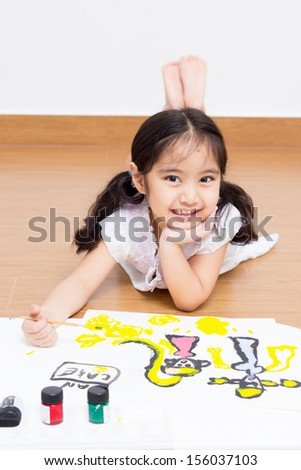 Little Asian artist kid drawing and painting  - stock photo