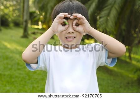 Little Asian boy having fun at outdoor park - stock photo