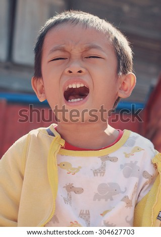 Little asian boy is angry - stock photo