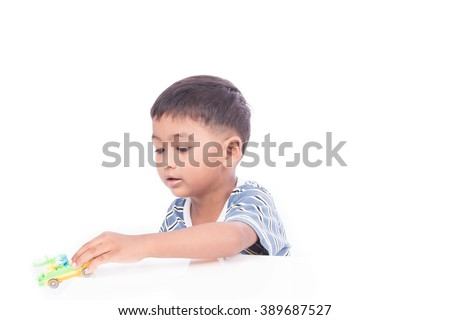 little asian boy play car plastic toy - stock photo