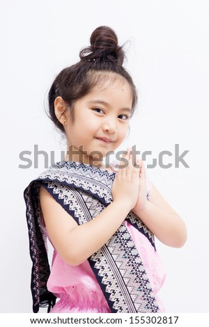 Little Asian child welcome expression Sawasdee.  - stock photo