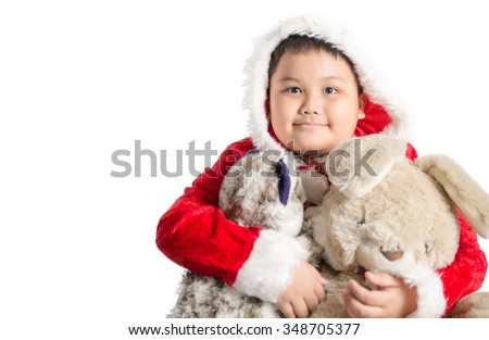 Little Asian fat boy in santa costume hugging rabbit doll on christmas isolated - stock photo