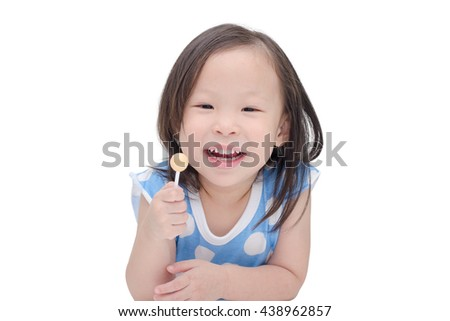 little asian girl holding a lollipop over white - stock photo