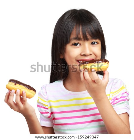 Little asian girl holding and eating chocolate donuts, Isolated on white background - stock photo