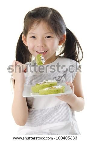 Little Asian girl is enjoying her dessert - stock photo