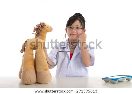 Little asian girl playing a doctor isolated on white background - stock photo