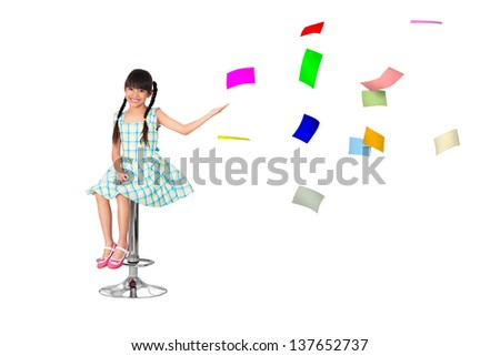 Little asian girl with a lot of flying papers, Isolated over white - stock photo