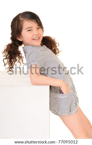 little asian girl with a smile - stock photo