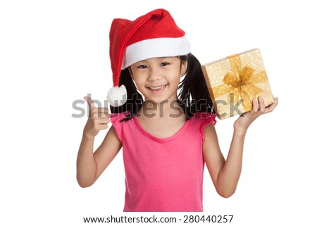 Little asian girl with santa hat and gift box  thumbs up  isolated on white background - stock photo