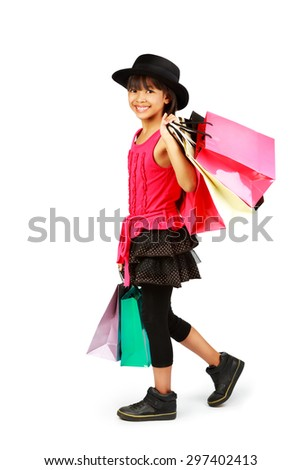 Little asian girl with shopping bags, Isolated over white - stock photo