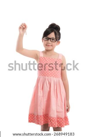 Little asian girl writing on white background isolated - stock photo
