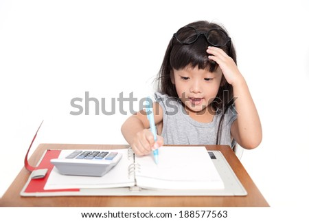 Little asian student girl with note book and calculator isolate on white background - stock photo