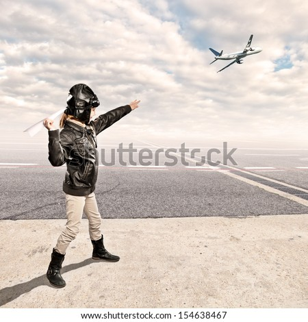 little aviator at the airport - stock photo
