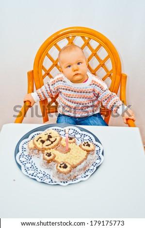 little baby and birthday cake - stock photo