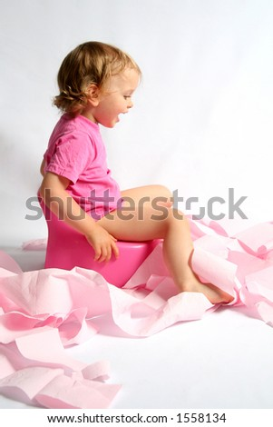 Little baby and pink potty - stock photo