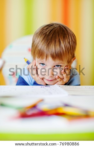 Little baby boy draws at home - stock photo