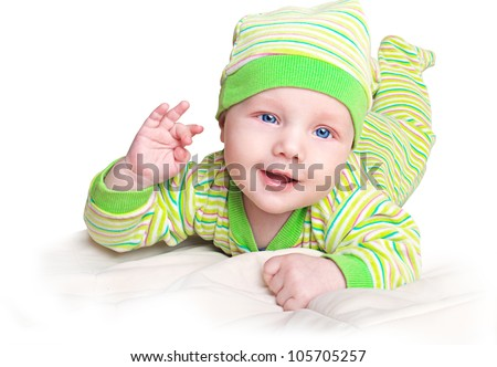 Little baby boy in a lime green pixie costume showing ok sign with his fingers - stock photo