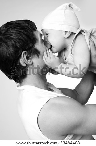 little baby boy in his father's hands - stock photo
