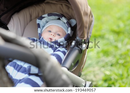 Little baby boy in stroller  - stock photo