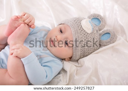 Little baby boy is in the suit of bear - stock photo