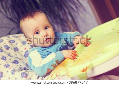 Little baby boy painter. Image with vintage filter - stock photo