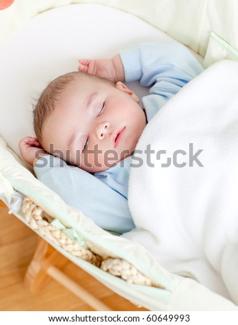 little baby boy sleeping in his bed - stock photo