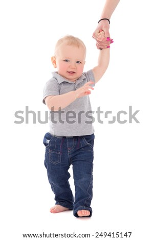 little baby boy walking and holding mother's hand isolated on white background - stock photo