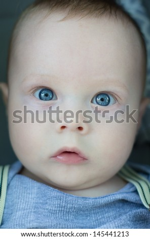 Little baby boy with blue eyes  portrait - stock photo