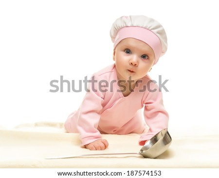Little baby cook with metal ladle on white background - stock photo