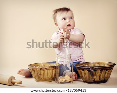 Little baby cooking - stock photo