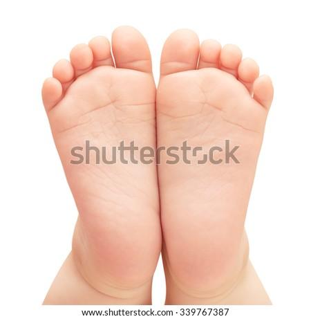 Little baby feet. - stock photo