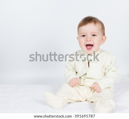 Little  baby funny boy in suit sitting. On white. - stock photo