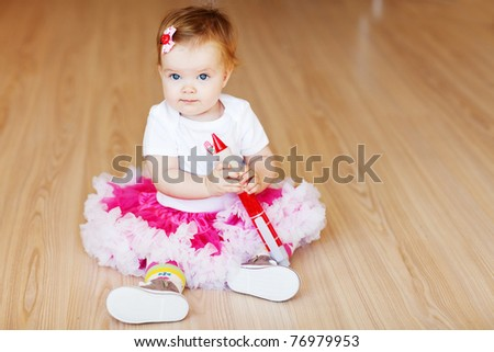 Little baby girl in a bright room - stock photo