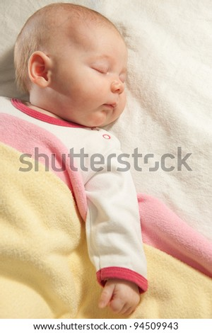 Little baby girl is sleeping at home - stock photo