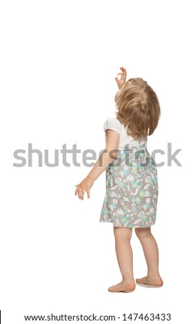 Little baby girl showing something above her, rear view, isolated on white - stock photo