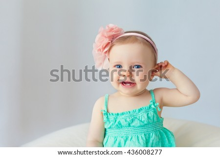little baby girl smiling with her first teeth - stock photo