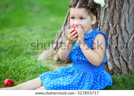 Little baby girl with apple - stock photo