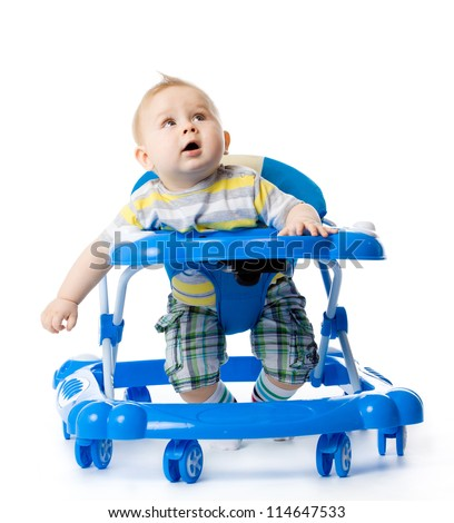 little  baby in the baby walker. - stock photo