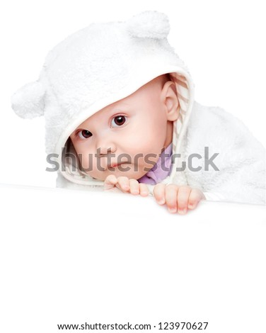 little baby in white bear costume isolated on white background with empty white board - stock photo